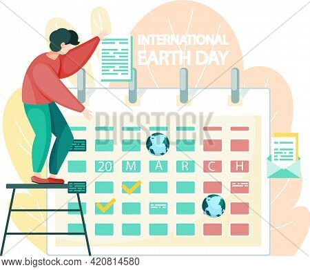 March 20 On Calendar. International Earth Day Concept. Guy Puts Mark On Calendar To Celebrate Holida