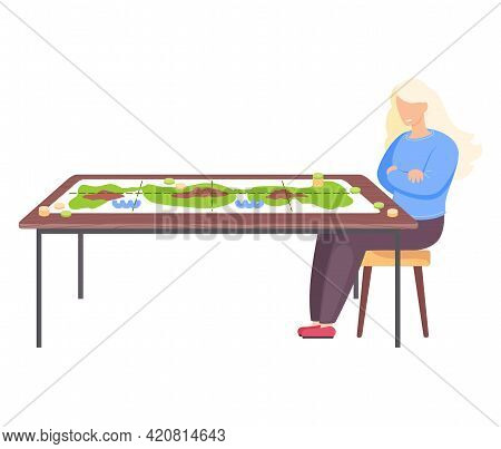Girl Sitting On Chair Next To Table With Colored Board Game And Coins. Young Woman Has Interesting H