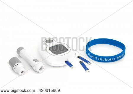 Diabetes monitoring and testing equipment kit with blood glucose monitor meter, lancing device, tester strip  type 2 diabetes alert rubber wristband in blue. On white background.