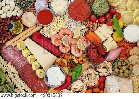 Mediterranean and flexitarian health food diet with seafood, meat, pasta, sauces, tomatoes, vegetables. High in antioxidants, anthocyanins, dietary fibre, omega 3, protein and lycopene. Flat lay.