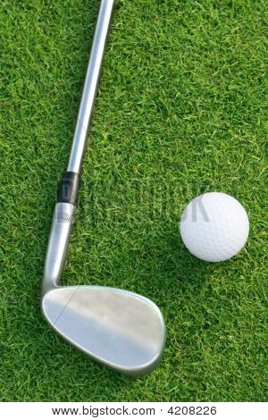 Golf Ball And Club On The Green