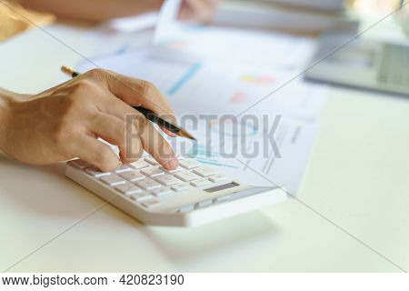 Close Up Of Businesswoman Working On Calculator To Calculate Business Data The Financial Report On W