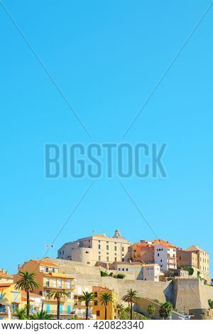 a view of the famous citadel of Calvi, in Corsica, France, against the blue sky in a clear summer day, with some blank space on top