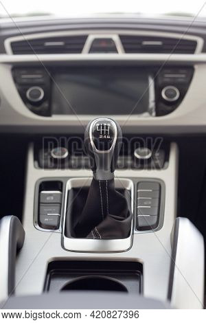 New Modern Unknown Car With Manual Transmission. Modern Transportation. Themed Blur Background. Clos