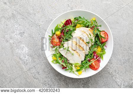 Chicken Breast Salad. Fresh Vegetable Salad With Tomato, Pepper, Arugula And Grilled Chicken Breast