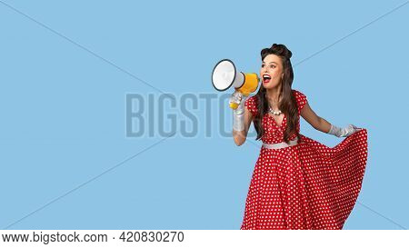Amazing Offer. Young Pinup Woman In Retro Style Dress Shouting Into Megaphone, Making Announcement