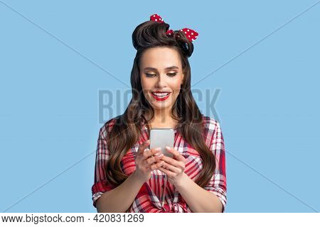 Beautiful Pinup Woman In Retro Outfit Using Smartphone, Browsing Internet, Checking Email Or Chattin