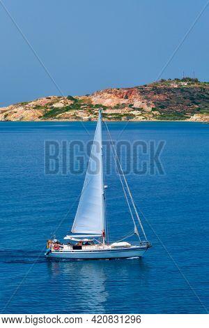 Yacht boat in blue waters of Aegean sea near Milos island , Greece