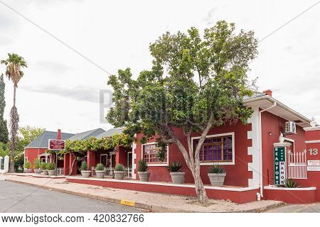 Beaufort West, South Africa - April 2, 2021: A Street Scene, With The Beaufort Manor Country House,