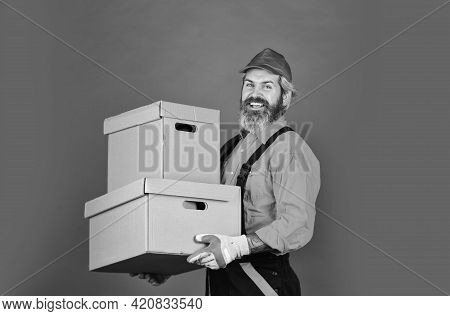 Living Better. Man Worker In Boilersuit Hold Box. Moving To A New Apartment. A New Wave Of Living. B