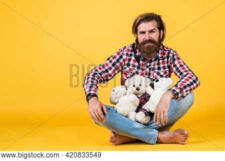 Nice Day For Shopping, Copy Space. Feel Happiness. Man With Beard Hold Cute Toy Bear. Man Holds Tedd