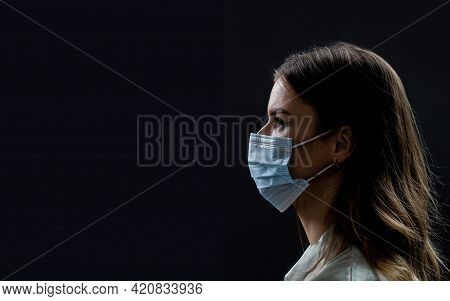 Faces Of People In Protective Masks From Coronavirus. Beautiful Quarantined Couple. Couple Wearing A