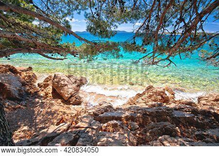 Idyllic Turquoise Beach View Through Pine Tree In Zadar Riviera, Pakostane In Dalmatia Region Of Cro