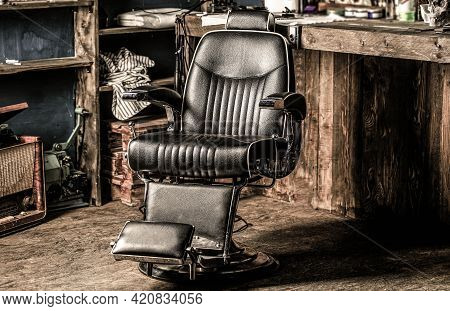 Stylish Vintage Barber Chair. Professional Hairstylist In Barbershop Interior. Barbershop Interior.