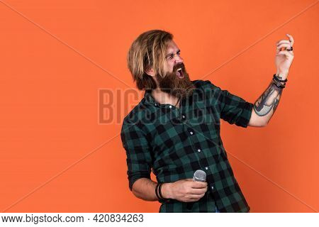 Karaoke Concept. Bearded Man In Checkered Shirt Sing Song. Casual Guy Express Human Emotions While S