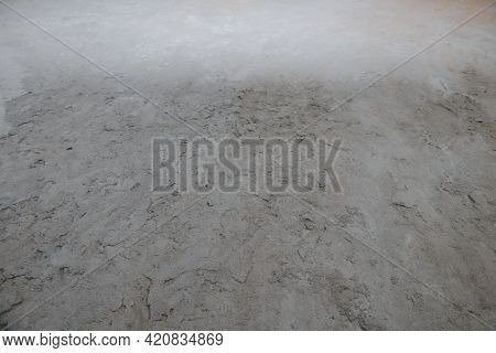 Uneven Surface Filled With A Cement-sand Mixture Of Gray Color