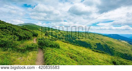 Trail Uphill The Alpine Meadow To The Distant Summit. Beautiful Mountain Landscape In Summertime. Cl