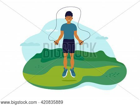 Outdoor Physical Activity On Fresh Air. Young Man Jumping In Park With Jump Ropes. Guy Training On N