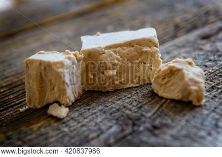 Fresh pressed active yeast, such yeast is used for baking bread and cakes as well as for beer production Saccharomyces cerevisiae