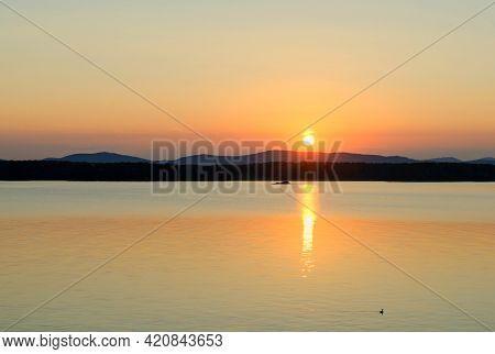Tropic sea sunset landscape - tropic sea water lit by sunset summer light. Tropic summer sunny water scene in colorful tones. Tropic sea summer nature, tropic sea vacation scene