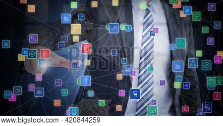 Composition of businessman touching screen with network of online digital icons. global online business, networking and digital interface concept digitally generated image.
