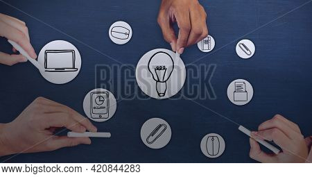Composition of online digital icons over people drawing on blue background. global online business and digital interface concept digitally generated image.