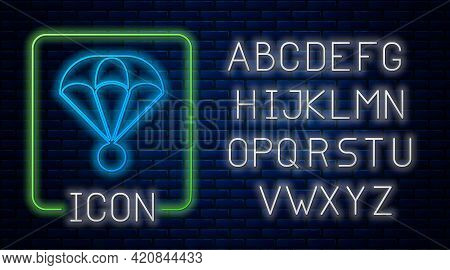 Glowing Neon Parachute Icon Isolated On Brick Wall Background. Extreme Sport. Sport Equipment. Neon