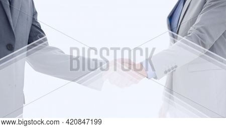 Abstract technology background over two businessmen shaking hands against white background. global business and technology concept