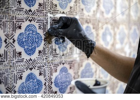 Restoring The Beauty Of Vintage Tile Azulejos On The Facade Of Old House