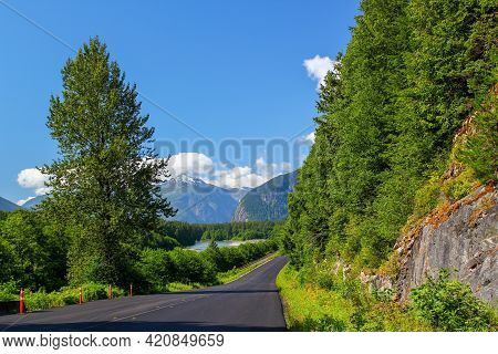 Typical Canadian Roadtrip Scenery: Beautiful Road In A Wonderful Nature Scenery. Rocky Mountains. Sk