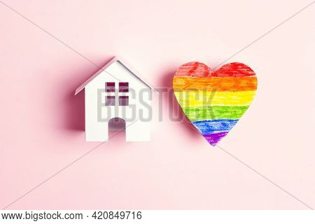 Toy House And Lgbt Rainbow Heart On Pink  Background. Tolerance To Homosexual And Bisexual People Co