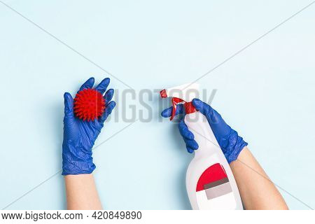 Hand In A Medical Gloves With An Antiseptic Spray Disinfects A Hand With A Abstract Coronavirus Mole