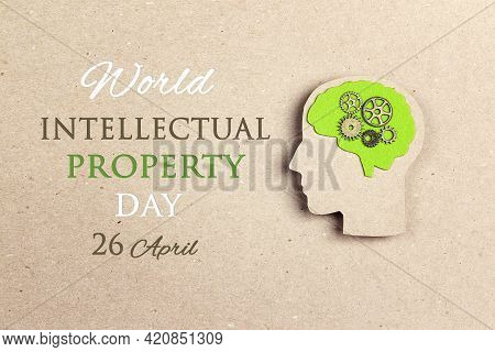 World Intellectual Property Day, April 26. Poster With Silhouette Human Head With Green Brain And Ge
