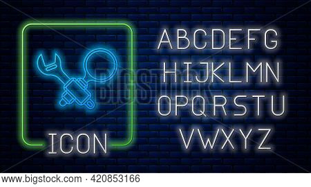 Glowing Neon Debugging Icon Isolated On Brick Wall Background. Debugging Tool. Magnifying Glass On B