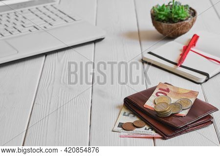 Leather Man's Open Wallet With Euro Banknotes, Coins On A White Wooden Table, Close-up, Selective Fo