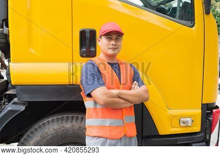 Asian Truck Driver In Safety Clothes Smile Confident. Happy Owner Transportation Business Stand Prou