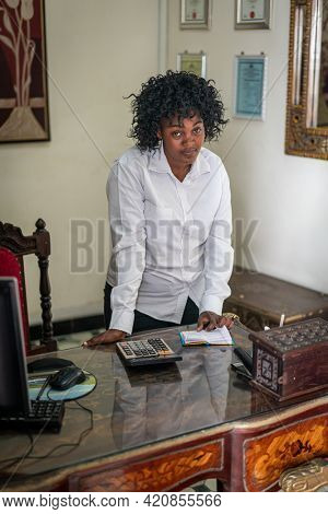 Real authentic African black businesswoman in the office
