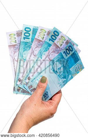 Woman Hand Showing One Hundred And Two Hundred Reais Bills On Isolated Background