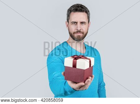 For You. Giftbox In Hand Of Successful Handsome Man. Selective Focus. Bearded Man With Business Rewa