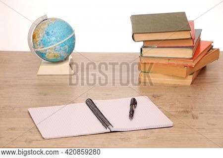 There Is A Globe And Study Materials On The Table In The Library To Prepare For Exams. Classroom Tea