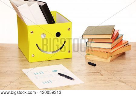 There Is A Yellow Box On The Table In The Library With Documents And Research Materials For The Prep