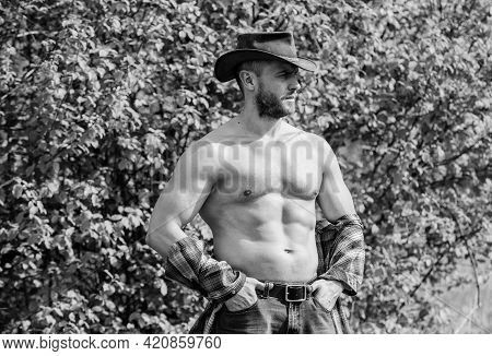 Macho Six Packs Torso Wear Rustic Style Clothes And Cowboy Hat. Strong And Confident Cowboy. Owner O