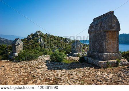 Lycian rock tombs, Glorious rock sarcophagus at ancient Lycian necropolis on hill in Simena, Kalekoy, Turkey