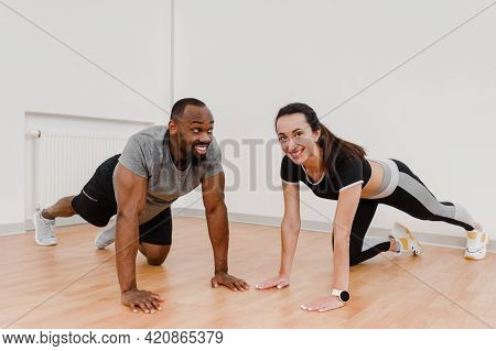 Portrait Of Happy Smiling Sportswoman And Laughing Athletic Man In Fitness Club
