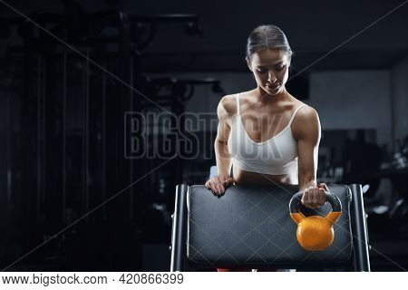 Athletic Fitness Woman With Kettlebell