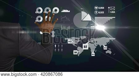 Composition of african american man over digital icons. global business, finance and networking concept digitally generated image.
