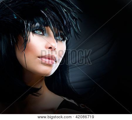 Fashion Art Portrait Of Beautiful Girl. Vogue Style Woman. Hairstyle. Black Hair. Isolated on Black Background. Beauty Stylish Model Portrait