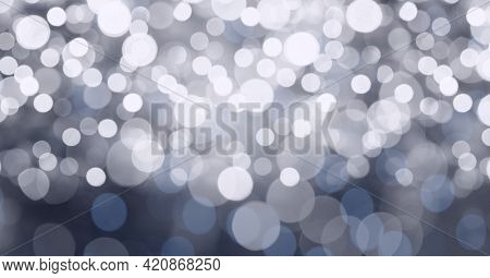 Digital generated image of spots of bokeh lights against grey background. abstract technology texture background concept