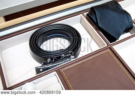 Leather Strap, Necktie And Other Accessories In The Storage Box