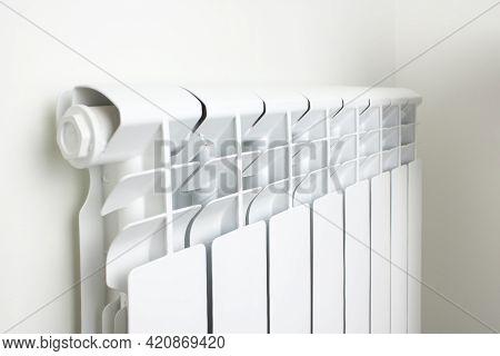 Central Heating Radiator. Heating Radiator, White Radiator In An Apartment.